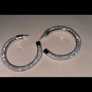 Swarovski encased silver tone earrings.